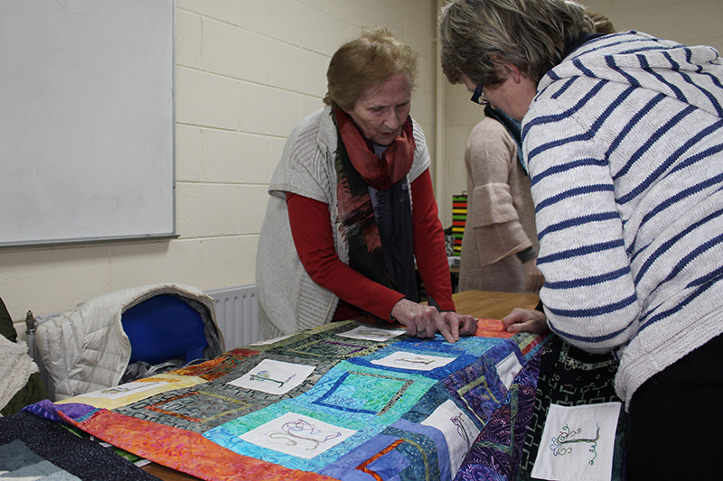 Apple Tree Crafts owners Marie and Trina O'Mahoney talk to Guild Members