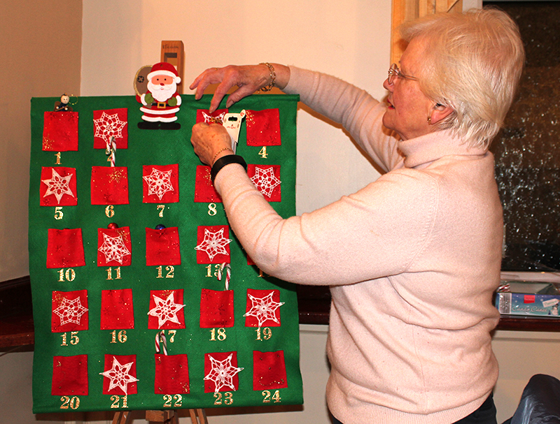 Betty setting up the Advent Calendar on an easel