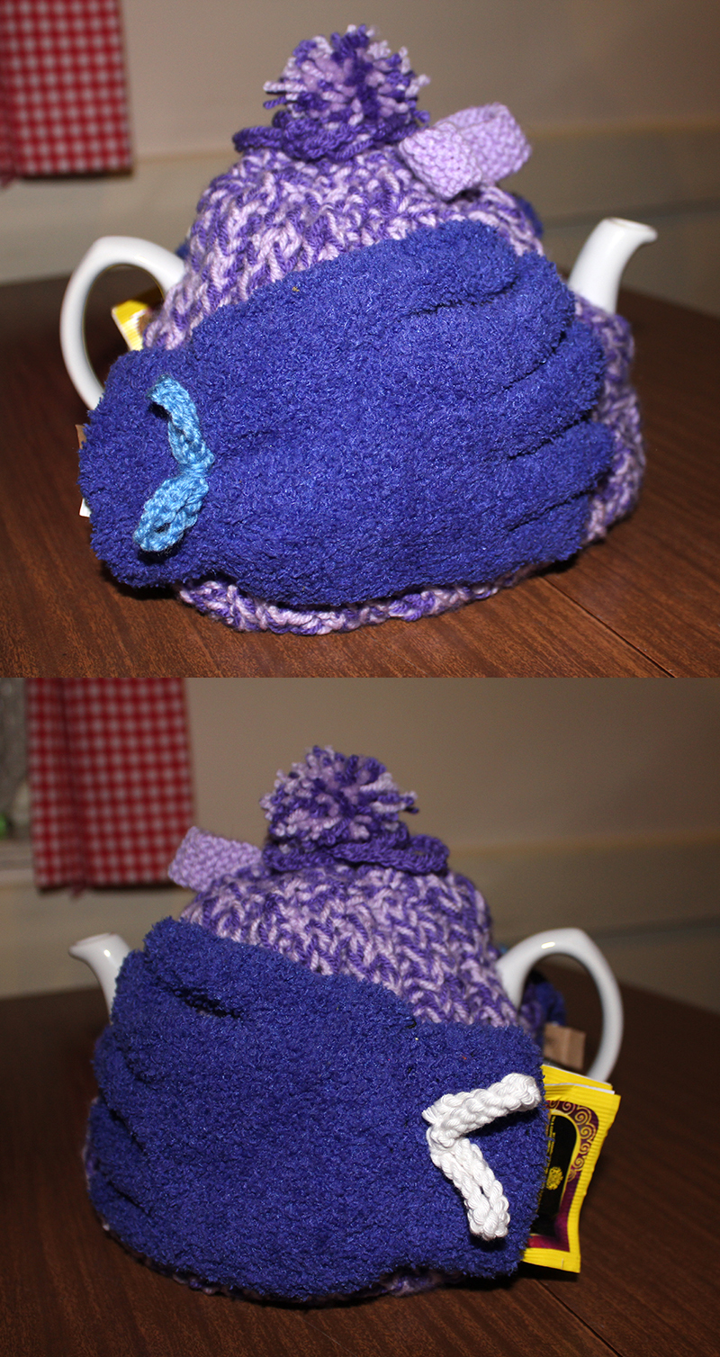 Mary DeCourcy's purple tea cosy with gloves on either side