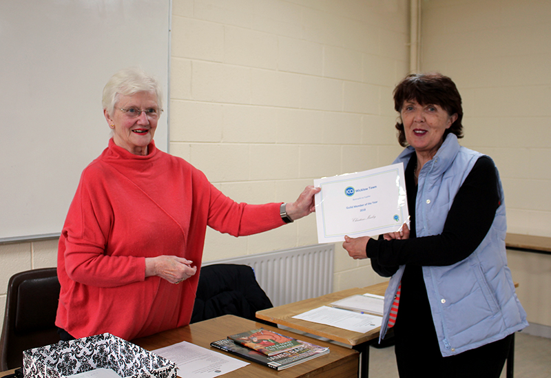 Betty Teahan handing Christina her Certificate