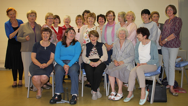 Guild Members laugh with Mary DeCourcy