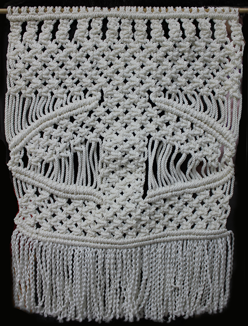 A Macrame wall hanging by Statia Ivers