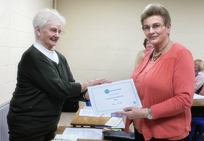 Betty Teahan handing Mary her Certificate