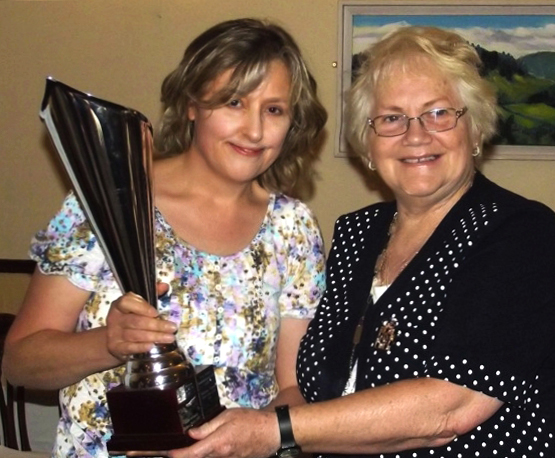 Susanna Braswell receives the Sadie Ryan Trophy for Creative Writing from Madge Kenny, Wicklow Federation President